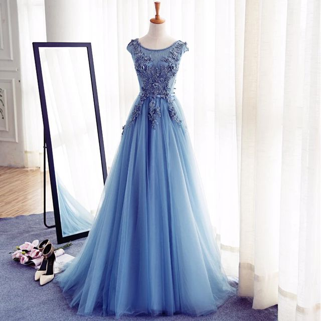 10f2a84837ed Blue Floor Length Tulle A-Line Prom Gown Featuring Floral Appliqués Bateau  Neck Bodice and Cap Sleeves